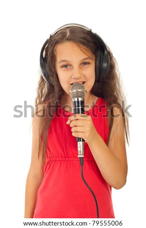 Beauty girl singing  into microphone and listening in headphones isolated on white background - stock photo