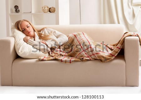 beauty girl sleeping on the sofa - stock photo
