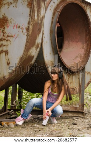 beauty girl with balloon paint sit in headphones near constructions - stock photo