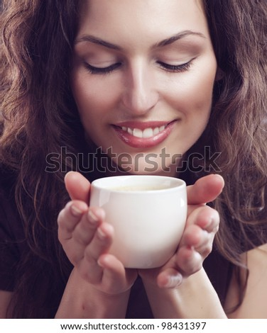 Beauty Girl With Cup of Coffee or Tea - stock photo