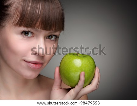 Beauty girl with green apple - stock photo