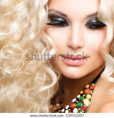Beauty Girl With Healthy Long Curly Hair. Blonde Woman Portrait. Blond Wavy Hair - stock photo
