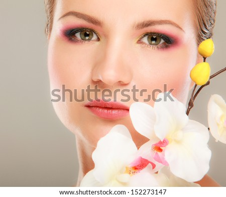 Beauty girl with orchid flowers - stock photo