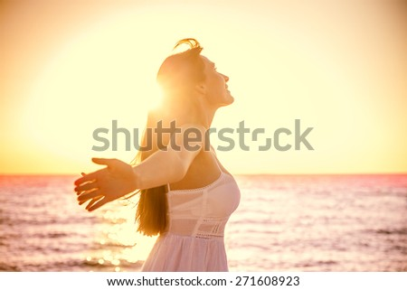 beauty girl with outstretched arms on the sea - stock photo