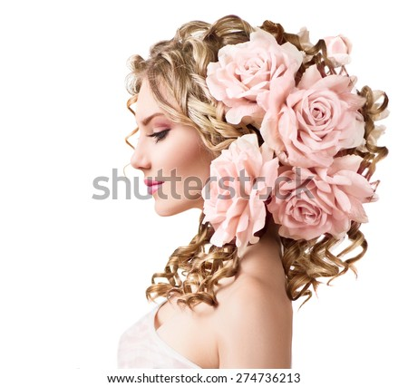 Beauty girl with rose flowers hairstyle isolated on white background. Fantasy girl portrait with pink flowers. Summer fairy portrait. Long permed curly hair. Perfect make up - stock photo