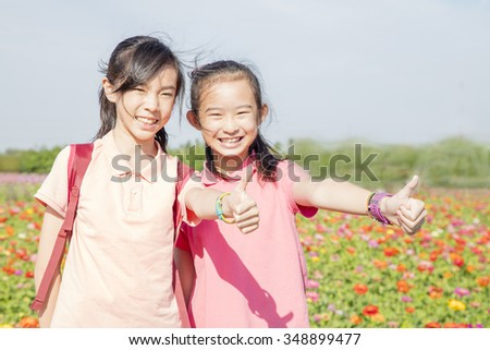Beauty girls in spring garden - stock photo