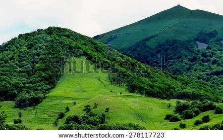 Beauty Green Hills Over Meadows at Sunny Day on Cloudy Sky background Outdoors - stock photo