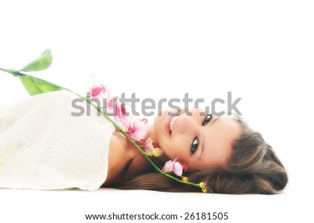 beauty halth and spa wellness isolated young woman face portrait closeup with towel and flower treatment - stock photo