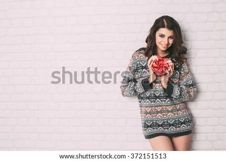 Beauty happy girl open Valentine gift box - stock photo