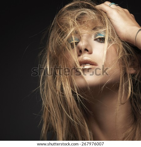 Beauty headshot of young sexy woman against dark background, beauty and makeup concept. - stock photo