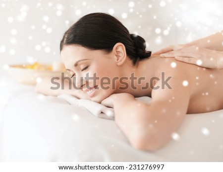 beauty, health, holidays, people and spa concept - beautiful young woman in spa salon getting massage - stock photo