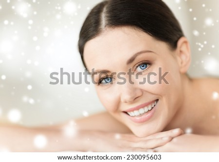 beauty, health, people and spa concept - beautiful young woman in spa - stock photo