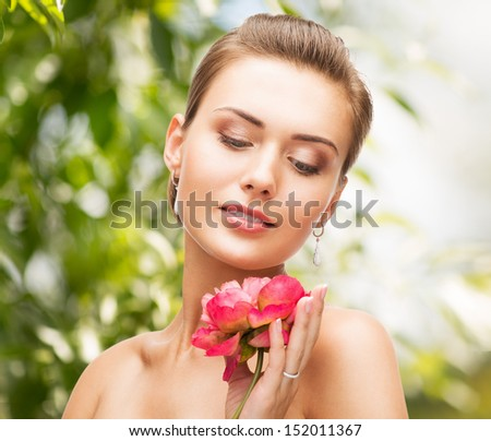beauty, holidays and jewelry - woman with diamond earrings, ring and flower - stock photo