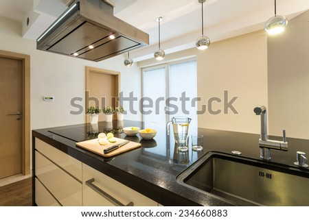 Beauty kitchen interior in beige and brown colors - stock photo