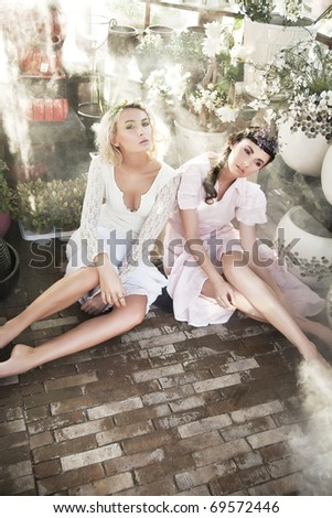 Beauty ladies in garden - stock photo