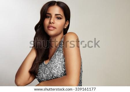 beauty latin woman wearing evening dress - stock photo