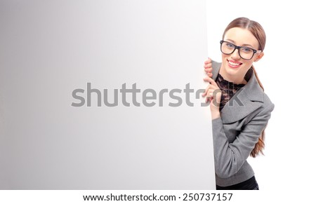 Beauty leaning at copy space. Beautiful young business woman looking at camera and smiling while leaning at copy space and isolated on white - stock photo