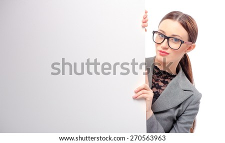 Beauty leaning at copy space. Beautiful young business woman looking at camera while leaning at copy space and isolated on white - stock photo