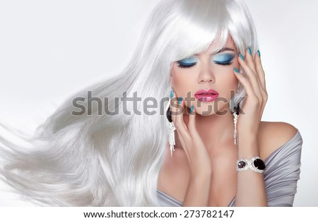 Beauty Makeup. Long hair. Blond girl with white wavy hairstyle in jewelry. Manicured nails. Salon of beauty. - stock photo