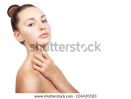 Beauty Model Girl Portrait . Beautiful Woman Face.  Isolated on White Background. Pretty Girl Touching her Face. Perfect clean skin and natural make up. Copy space. - stock photo