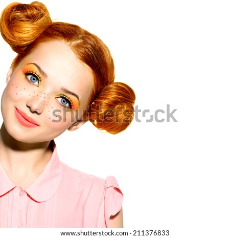 Beauty Model Girl portrait isolated on white. Beautiful Joyful teen girl with freckles, funny red hairstyle and yellow and orange makeup . Professional make up. Isolated on a white background  - stock photo