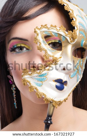 beauty model girl with carnival mask - stock photo