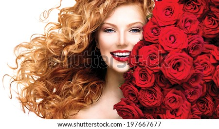 Beauty model girl with long curly red hair and beautiful red roses hairstyle. Fashion woman with blowing Wavy healthy hair isolated on white background - stock photo
