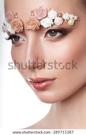 beauty model headshot portrait with creative makeup,  eyebrows from flowers - stock photo
