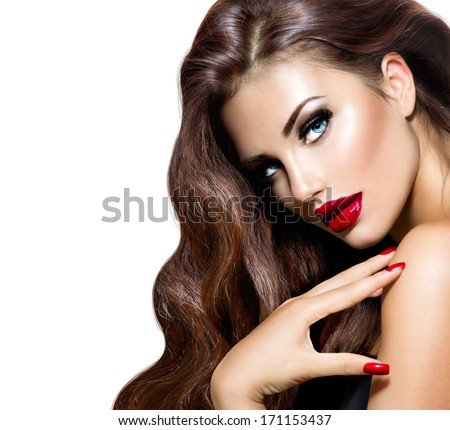 Beauty Model Woman with Long Brown Wavy Hair. Healthy Hair and Beautiful Professional Makeup. Red Lips and Smoky Eyes Make up. Gorgeous Glamour Lady Portrait. Red Manicure. Haircare, Skincare concept - stock photo