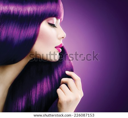 Beauty Model Woman with perfect make up and Healthy coloring violet Hair. Glamour Beautiful girl taking her long smooth shiny straight hair. Hairstyle. Hair cosmetics, haircare  - stock photo