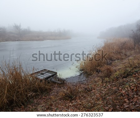 beauty morning's fog over the mystic river - stock photo