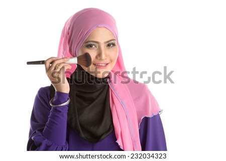 Beauty Muslim Asian girl with Makeup Brush. Makeup. Cosmetic. Base for Perfect Make-up.Applying Make-up - stock photo