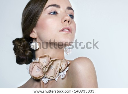 Beauty.Nude make-up.Female portrait .Luxury. White background. Close-up. Space. Natural make-up.Grey.Necklace.Earring.Eyebrows.Full lips.Girl .Woman - stock photo
