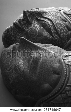 Beauty of mysterious masks; studio, monochrome - stock photo