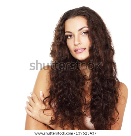 Beauty of young fresh woman with long brown healthy curly hair. Isolated on white background - stock photo