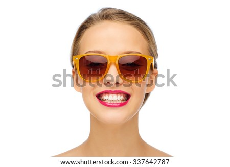 beauty, people, accessory and fashion concept - smiling young woman in sunglasses with pink lipstick on lips - stock photo