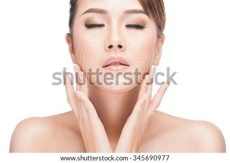 beauty, plastic surgery, aging, people and health concept - beautiful young woman touching her face with lifting arrows isolated on white with clipping path - stock photo