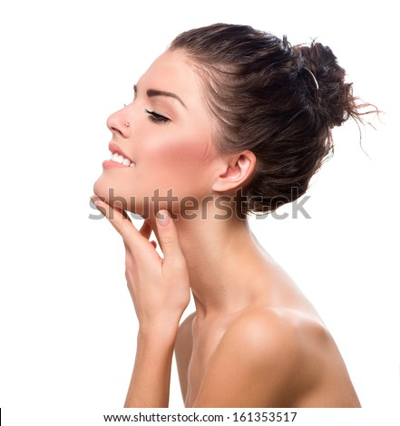 Beauty Portrait. Beautiful Spa Girl Touching her Face. Perfect Fresh Skin. Pure Beauty Model Girl. Youth and Skin Care Concept. Beauty Smiling Teenage Model Girl Portrait  - stock photo