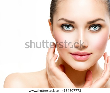 Beauty Portrait. Beautiful Spa Woman Touching her Face. Perfect Fresh Skin. Isolated on White Background. Pure Beauty Model. Youth and Skin Care Concept - stock photo