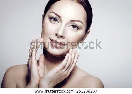Beauty Portrait. Beautiful Spa Woman Touching her Face. Perfect Fresh Skin. Pure Beautiful Model Girl. Youth and Skin Care Concept . - stock photo