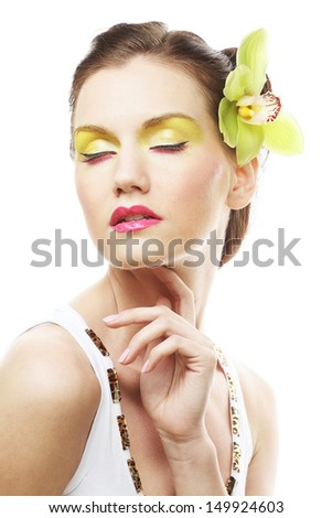 Beauty Portrait. Beautiful stylish girl with orchid flower in hair. - stock photo