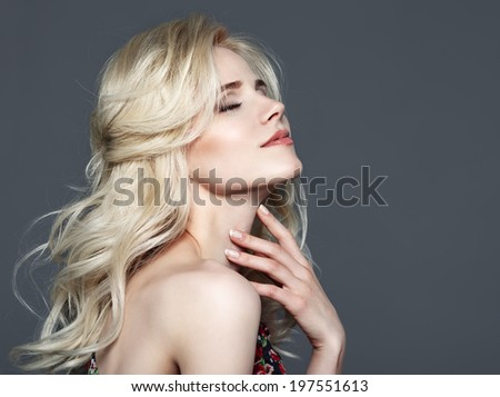 Beauty Portrait. Beautiful Woman Touching her neck. Perfect Fresh Skin. Isolated on Grey Background. Pure Beauty Model. Youth and Skin Care Concept - stock photo