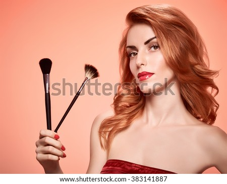Beauty portrait nude woman eyelashes, perfect skin, red lips, fashion. Gorgeous sensual attractive pretty redhead sexy model girl with makeup brushes on pink, shiny wavy hair. People face, copyspace - stock photo