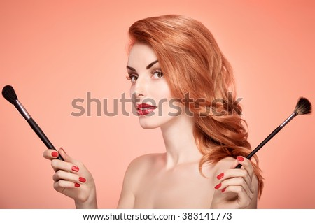 Beauty portrait nude woman smiling, eyelashes, perfect skin, red lips, fashion.Gorgeous sensual attractive pretty redhead sexy model girl with makeup brushes on pink, shiny wavy hair.People, copyspace - stock photo