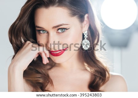 Beauty portrait of a charming woman looking at camera  - stock photo