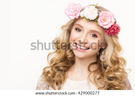 Beauty portrait of a cheerful girl with wreath of flowers. Isolated on white background with copyspace for your text. Beautiful young woman with blond hair and blue eyes. Youth, happiness concept. - stock photo