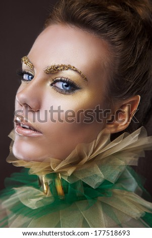 beauty portrait of a golden queen of elves - stock photo