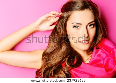 Beauty portrait of a positive young woman in spectacles and bright yellow dress over green background. Beauty, fashion. Optics. - stock photo