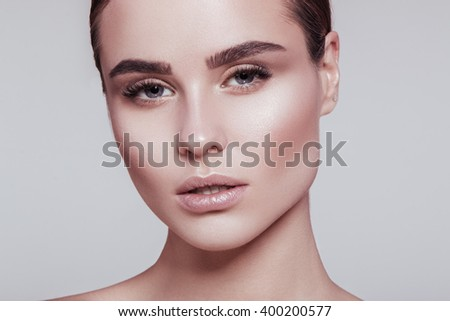 Beauty portrait of a very beutiful brown hair european young girl, nude make up, strong woman. Studio shoot, white background. Highlight skin. Model posing and Looking at the camera.  - stock photo