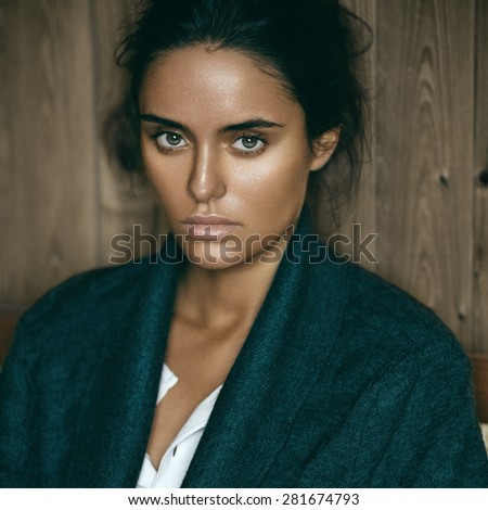 Beauty portrait of a young sensual brunette girl with stylish hairstyle. - stock photo